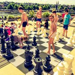 Giant chess board on roof top terrace/cafe