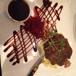 Deer steak with mashed potato, panchetta, mushrooms, ligonberry sauce and a port wine gravy from