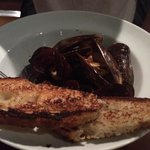 Sorry, already started...The Mussel entrée. It was small serve but the mussels are very big and