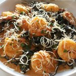 Shrimp and squid ink fettuccine, fresh cheese grated on top at the table. The strands of cheese