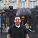 My husband in front of the Theatre