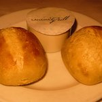 Homemade sourdough rolls baked fresh with garlic chive compound butter