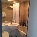 Bathroom with full amenity kit.