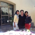 my family with hostess, Marion in backyard on last breakfast