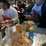 Tables covered in wax paper, bibs, and your food comes out in bags! Awesomeness!!