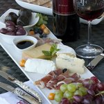 Enjoy a cheese and meat platter with us