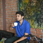 Ayan having a cup of coffee