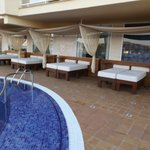 beds at pool area to relax