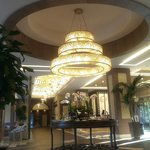 Холл отеля и стол со сладостями