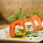 Caprese Salad - Plum tomatoes stuffed with Bononcini cheese, served with fresh basil