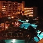 View from Balcony overlooking pool at night