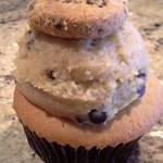 Cookies & Milk Cupcake.  Brown sugar cupcake with chocolate chips topped with chocolate chip but