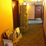 About 8:15am; storage room door closed, but still boxes and cardboard outside in the hallway.