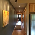 hall way with art leads to each bedroom
