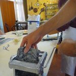 Rolling out squid-ink pasta for fettuccine