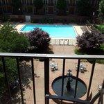 Balcony overlooking courtyard and pool