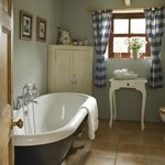 The blue room en suite with roll top bath and shower