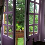 View out french doors and mill race from the Lilac room.