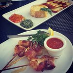 Start off with our baked Brie w/ red pepper jelly + pesto or our bacon wrapped scallops.