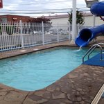 The only outdoor pool is this small area, which the waterslide empties into