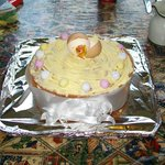 a very clever and delicious Easter cake, decorated with chick, eggshell, and ribbon