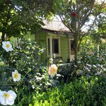 Cottage tucked into a beautiful garden ... simply charming