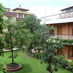 Shechen Guest House rooms and garden