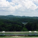 The view from Moses H. Cone Manor of Bass Lake as well as the Blue Ridge Mountains in the distan