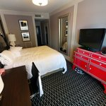 Wide view of Standard King -- Dresser is oddly placed and blocks passage at end of bed