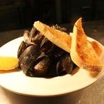 Steamed Mussels in a Tarragaon, shallots, tomato butter wine sauce