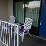 Balcony overlooking the pool - Bring a pet gate if you want your dog to sit outside