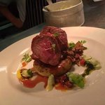 Roasted Rump of Lamb with basil, olive and tomato braised lamb shoulder and creamed broad beans