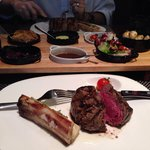 Medium rare filet. All steaks are served with bone marrow and a salad and sauce. I got red wine