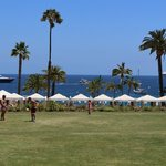 playing field above Descanso Beach with superyacht and Carnival