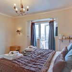 Room 8 - a lovely and bright 2nd floor rear facing room with king size bed and en-suite bath & s