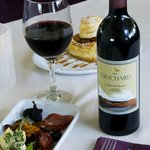 A Savory Share Platter nosh plate for two with some deep red wine