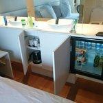 The mini fridge and kettle/tea cups