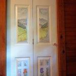 Hand painted folding door to bathroom