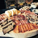 Huge platter of cured meat and cheese..