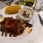 Half-rack of lamb ribs with corn on the cob side order