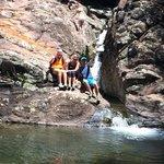 Sitting near a mini waterfall