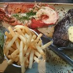 Steak medium and lobster from the other plate. June 2014.