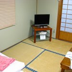The room is equipped with TV, phone and 2in1 air-conditioning/heater