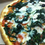 Close up spinach pizza