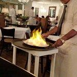 Salt-encrusted fish set aflame - the result was EXCELLENT!