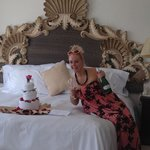 Junior suite with bottle and towel cake