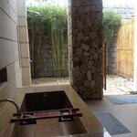 cliff villa bathroom with rain shower outside