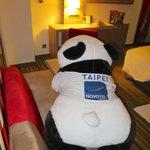 Giant stuffed panda in executive room