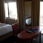 suite consists of King bed double sleeper couch desk and chair with tea/coffee, tv, wi-fi