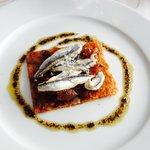 Tarte aux anchois et oignons caramélisés